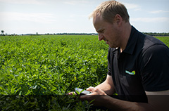 James Parsons in the field with the farming app Field Tracker Pro.